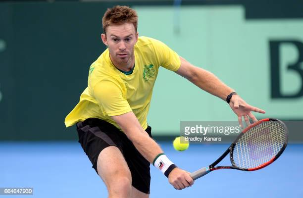 John Peers of Australia plays a backhand volley during practice ahead of the Davis Cup World Group Quarterfinal match between Australia and the USA...