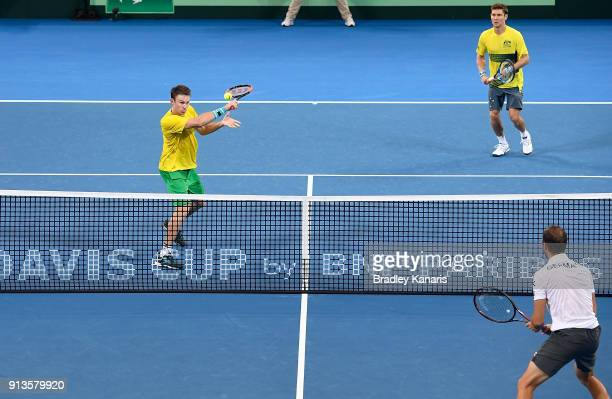 John Peers of Australia plays a backhand volley in the doubles match with Matt Ebden against Jan-Lennard Struff and Tim Putz of Germany during the...
