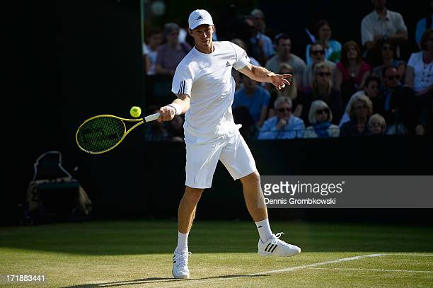 John Peers of Australia plays a forehand during the Mixed Doubles first round match between Julian Knowle of Austria and Shuai Zhang of China and...