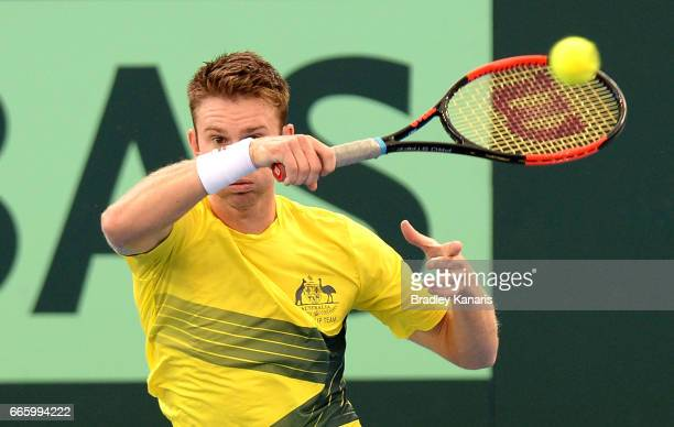 John Peers of Australia plays a forehand in his doubles match against Steve Johnson and Jack Sock of the USA during the Davis Cup World Group...