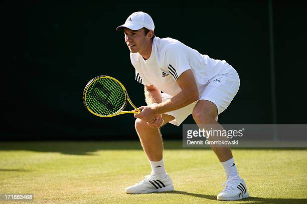 John Peers of Australia prepares to receive a serve during the Mixed Doubles first round match between Julian Knowle of Austria and Shuai Zhang of...