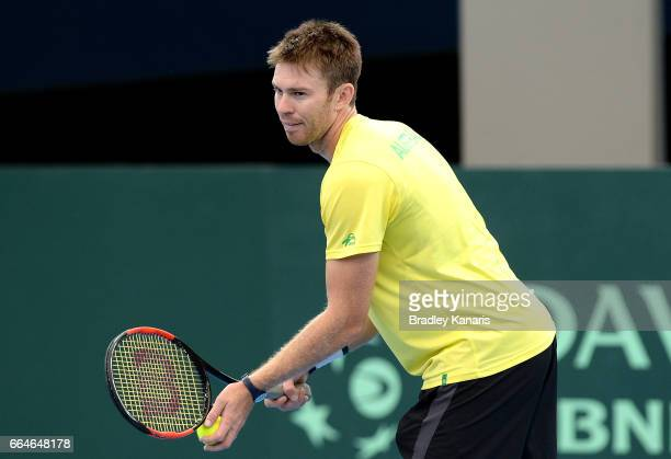 John Peers of Australia serves during practice ahead of the Davis Cup World Group Quarterfinal match between Australia and the USA at Pat Rafter...