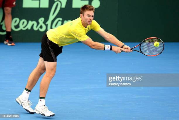 John Peers of Australia stretches out to play a shot during practice ahead of the Davis Cup World Group Quarterfinal match between Australia and the...