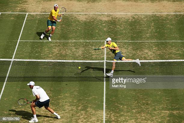 John Peers of Australia volleys playing with Sam Groth in the doubles match against Andrej Martin and Igor Zelenay of Slovakia during the Davis Cup...