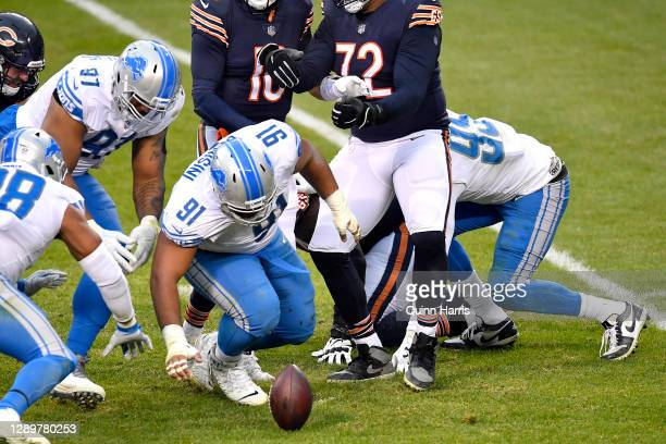 John Penisini of the Detroit Lions recovers a fumble lost by Mitchell Trubisky of the Chicago Bears during the second half at Soldier Field on...