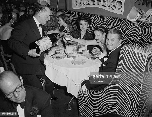John Perona owner of El Morocco nightclub 154 East 54th Street New York City celebrating New Year's Eve with guests