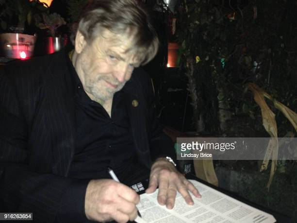 John Perry Barlow cofounder of the Electronic Frontier Foundation and lyricist for the Grateful Dead holds still in dim light as he takes a quiet...