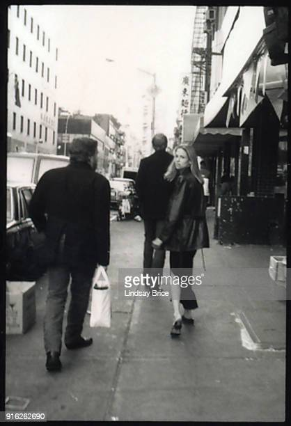 John Perry Barlow Grateful Dead lyricist and Electronic Freedom Foundation cofounder walks together with artist John Currin and Barlow's daughter...