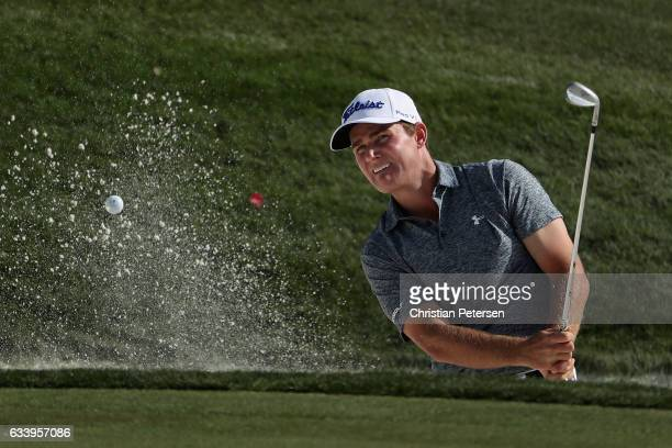 John Peterson chips from the bunker onto the 12th green during the final round of the Waste Management Phoenix Open at TPC Scottsdale on February 5,...