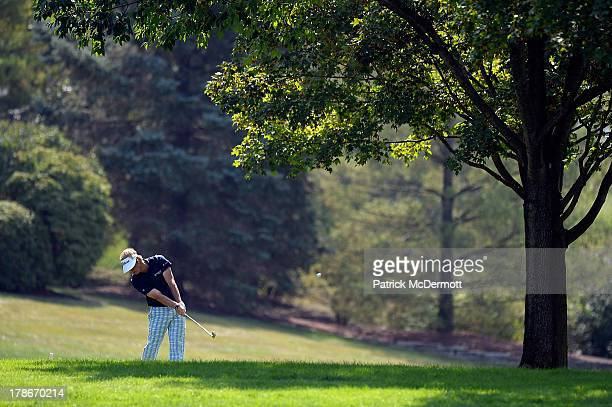 John Peterson hits his second shot on the eighth hole during round two of the 2013 Hotel Fitness Championship at Sycamore Hills Golf Club on August...
