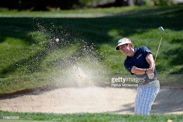 John Peterson hits out of a bunker to the seventh green during round two of the 2013 Hotel Fitness Championship at Sycamore Hills Golf Club on August...