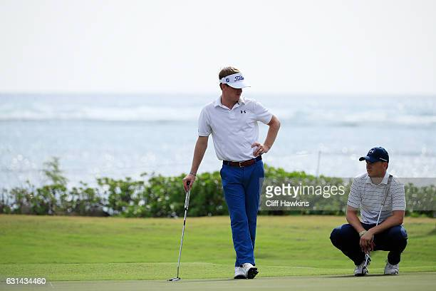 John Peterson of the United States and Jordan Spieth of the United States look on during practice rounds prior to the Sony Open In Hawaii at Waialae...