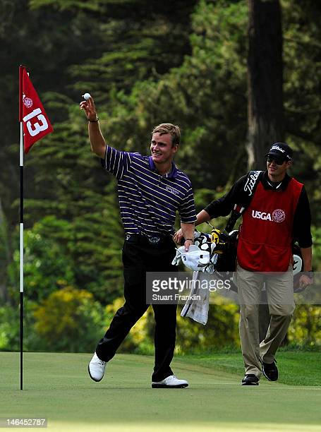 John Peterson of the United States celebrates a holeinone on the 13th hole with his caddie Gentry Mangun during the third round of the 112th US Open...