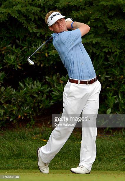 John Peterson of the United States hits his tee shot on the 11th hole during Round One of the 113th US Open at Merion Golf Club on June 13 2013 in...