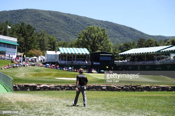 John Peterson walks to his second shot on the 18th hole during the final round of A Military Tribute At The Greenbrier held at the Old White TPC...