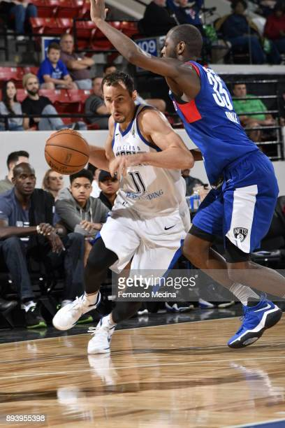 John Petrucelli of the Lakeland Magic drives against Milton Doyle of the Long Island Nets during the game on December 16 2017 at RP Funding Center in...