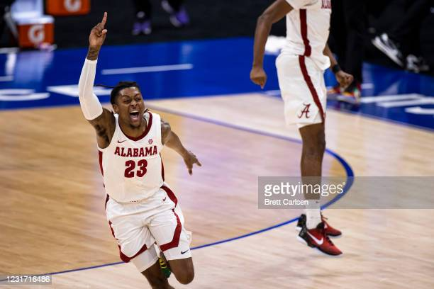 John Petty Jr. #23 of the Alabama Crimson Tide celebrates after the championship game against the LSU Tigers in the SEC Men's Basketball Tournament...