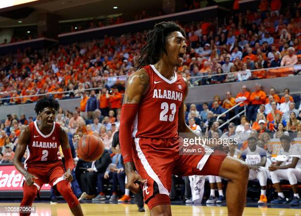 John Petty Jr. #23 of the Alabama Crimson Tide dunks against Allen Flanigan of the Auburn Tigers in the first half at Auburn Arena on February 12,...