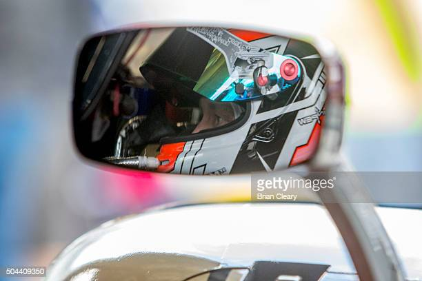 John Pew is reflected in his mirror as he sits in his car during the Roar Before the 24 IMSA WeatherTech Series testing at Daytona International...