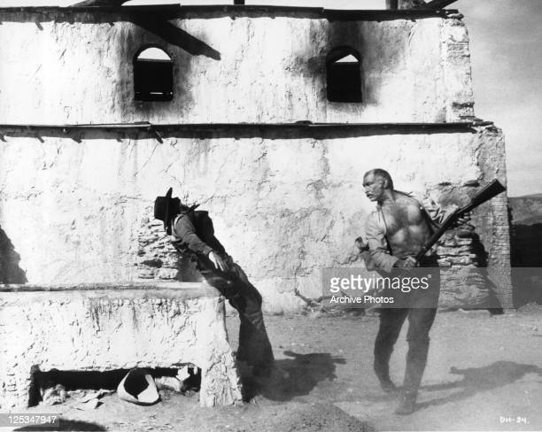 John Phillip Law is knocked back by Lee Van Cleef with the back of a riffle in a scene from the film 'Death Rides A Horse' 1967