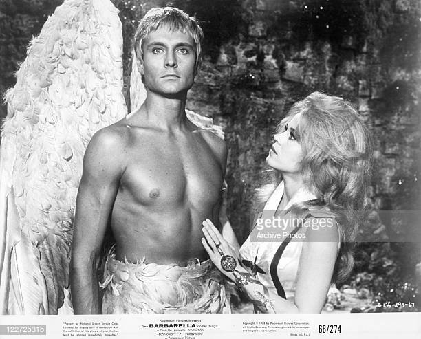 John Phillip Law with wings as Jane Fonda touches him in a scene from the film 'Barbarella', 1968.