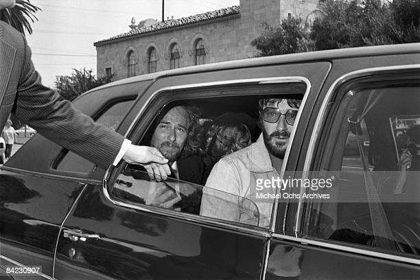 John Phillips and Denny Doherty attend the funeral for singer Cass Elliot of The Mamas And The Papas at Groman Mortuary on August 2 1974 in Los...