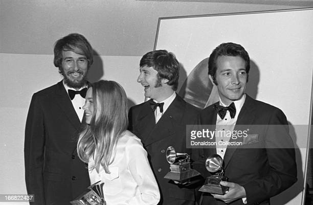John Phillips Michelle Phillips and Denny Doherty of the folk rock group 'Mamas And The Papas' join composer Herb Alpert backstage at the 9th Grammy...