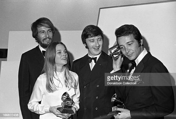 "John Phillips, Michelle Phillips and Denny Doherty of the folk rock group ""Mamas And The Papas"" join composer Herb Alpert backstage at the 9th Grammy..."