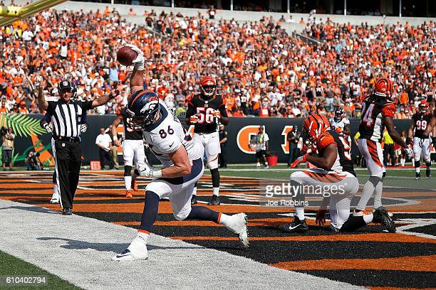 John Phillips of the Denver Broncos celebrates after scoring a touchdown during the fourth quarter of the game against the Cincinnati Bengals at Paul...