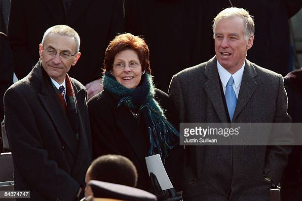 John Podesta and Howard Dean stand on the inaugural platform before the inauguration of Barack Obama as the 44th President of the United States of...