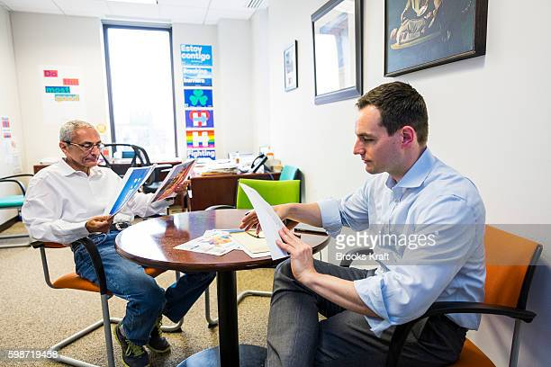 John Podesta Campaign Chairman and Robby Mook Campaign Manager for Democratic presidential candidate Hillary Clinton meet inside the campaign...
