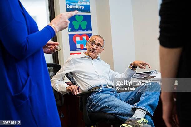 John Podesta Campaign Chairman for Democratic presidential candidate Hillary Clinton talks with staff at campaign headquarters June 28 2016 in...