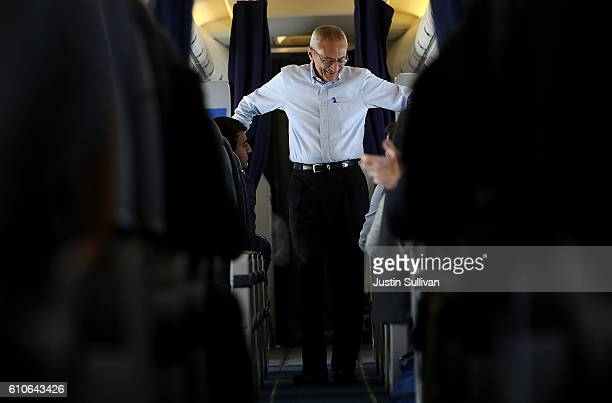 John Podesta campaign chairman for democratic presidential nominee former Secretary of State Hillary Clinton aboard the the Clinton campaign plane...