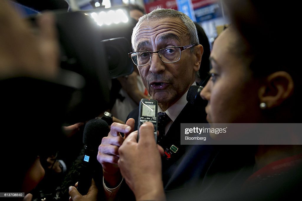 John Podesta, campaign chairman of the 2016 Democratic Nominee Hillary Clinton, speaks to members of the media in the spin room after the second U.S. presidential debate at Washington University in St. Louis, Missouri, U.S., on Sunday, Oct. 9, 2016. Donald Trump and Clinton combined salacious charges about past sexual scandals with sober discussion of substantive topics during their second presidential debate Sunday night following a weekend of unprecedented crisis in the Republican nominee's campaign. Photographer: Andrew Harrer/Bloomberg via Getty Images