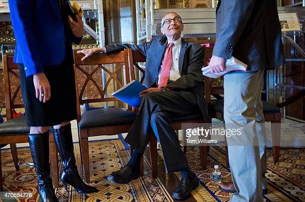 John Podesta chairman of Hillary Clinton's 2016 presidential campaign talks with a reporter before the senate policy luncheons in the Capitol April...
