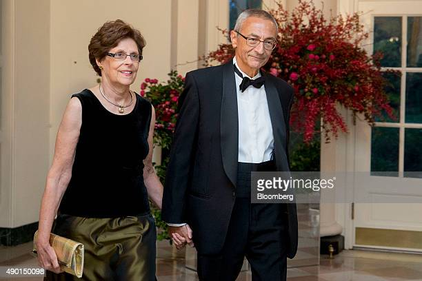 John Podesta chairman of Hillary Clinton's 2016 presidential campaign right and Mary Pedesta arrive at a state dinner in honor of Chinese President...