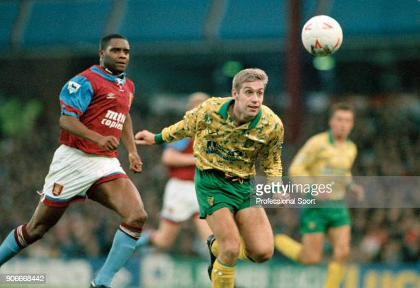 John Polston of Norwich City watched by Dalian Atkinson of Aston Villa during an FA Carling Premiership match at Villa Park on November 28 1992 in...