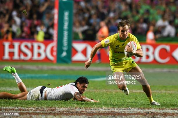 John Porch of Australia breaks the tackle of Maka Unufe of the US during the bronze medal match on the third and final day of the Hong Kong Rugby...