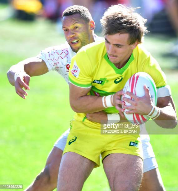 John Porch of Australia is tackled by Dan Norton of England during their 5th Place semifinal match at the USA Sevens Rugby tournament on March 3 2019...