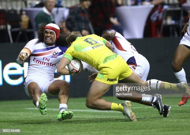John Porch of Australia is tackled by Folau Niua of the United States during the Canada Sevens the Sixth round of the HSBC Sevens World Series at the...
