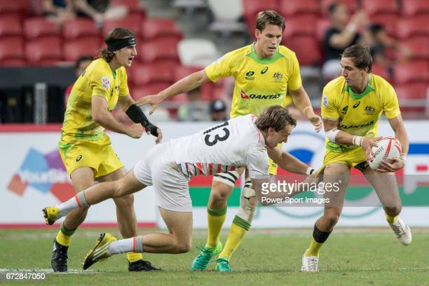 John Porch of Australia runs with the ball while Harry Glover of England tries to stop him during the match Australia vs England the Bronze Final of...