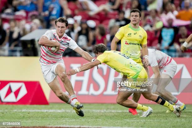 John Porch of Australia tries to stop Harry Glover of England who runs with the ball during the match Australia vs England the Bronze Final of Day 2...