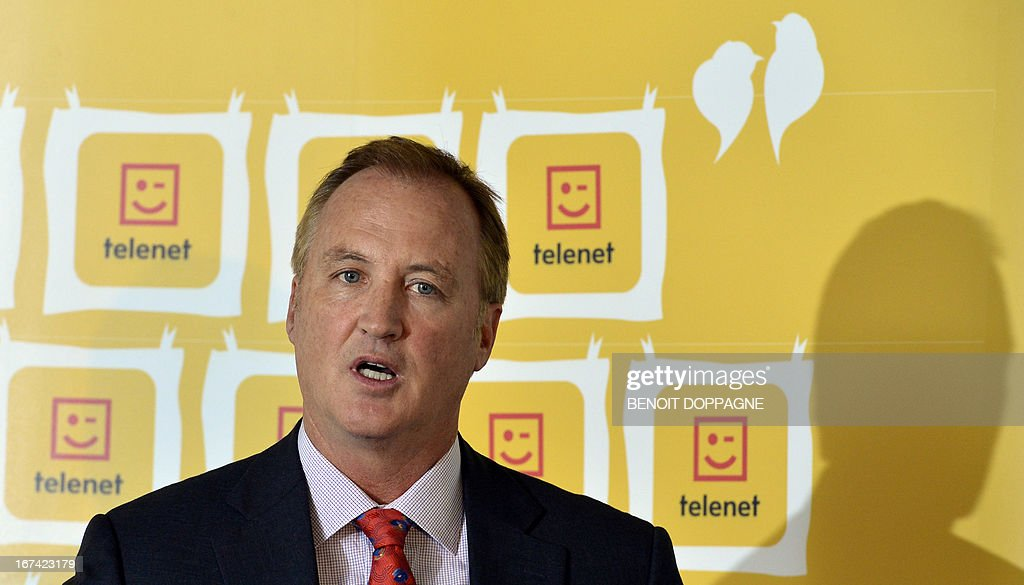 John Porter, CEO of Telenet, speaks at a press conference to announce the results of the 1st Quarter of 2013 of Belgian telecom group Telenet, at the Telenet headquarters in Mechelen, on April 25, 2013.
