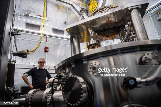 John Pratt NIST researcher is seen next to the Watt Balance instrument at the National Institute of Standards and Technology on Tuesday November 13...