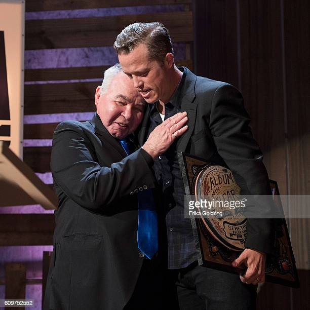 John Prine presents Jason Isbell with the Album of the Year Award at Ryman Auditorium on September 21 2016 in Nashville Tennessee