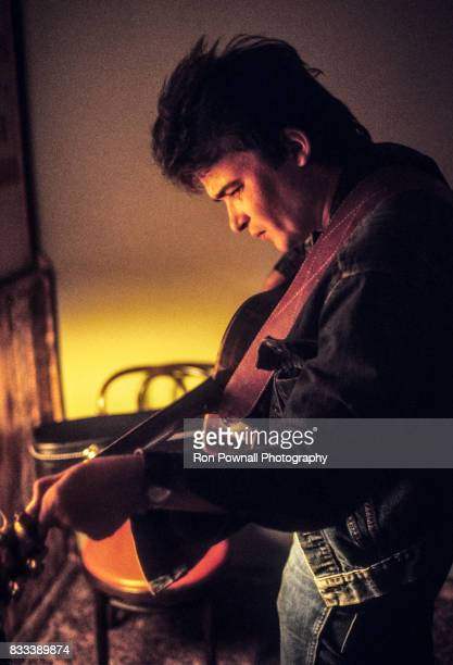 John Prine tunes-up backstage at The Telagi music club in October 1972 in Boulder, Colorado