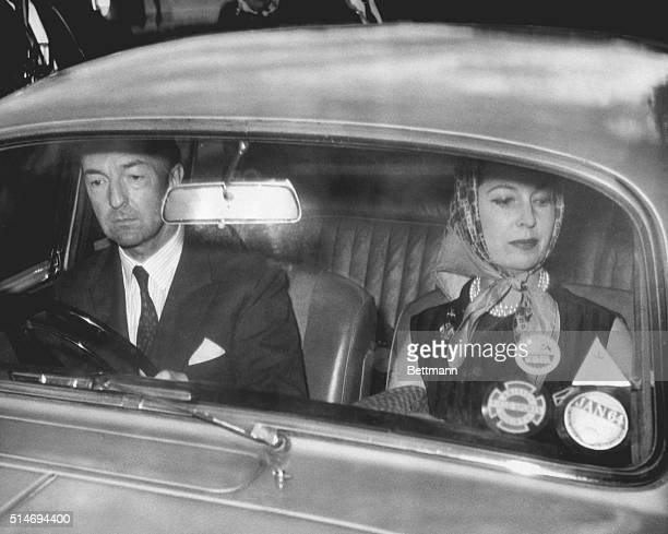 John Profumo Britain's former minister of war drives his car to his home with his actress wife Valerie Hobson Profumo resigned from his post in early...