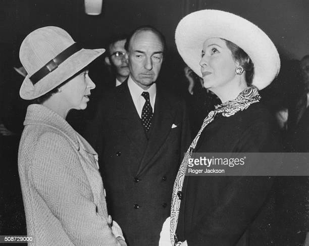John Profumo Former Secretary of State for War and his wife Valerie Hobson meeting Queen Elizabeth II following the opening of the home of the Attlee...