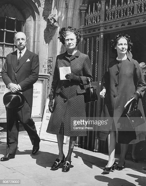 John Profumo Former Secretary of State for War pictured leaving Westminster Abbey with his wife Valerie Hobson and his mother after attending a...