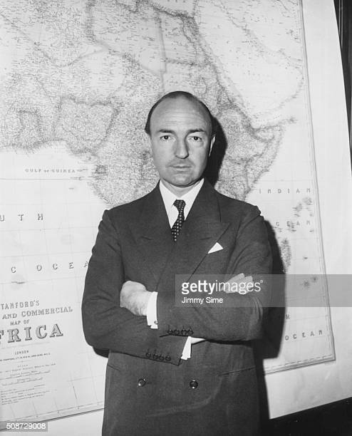John Profumo the new Secretary of State for War pictured standing in front of a large map of Africa in the War Office London July 29th 1960